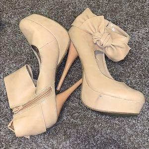 Nude platform bow stilettos